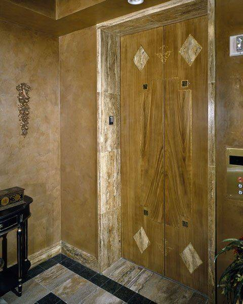This Faux Woodgrained Metal Door With Painted Inlays Of Walnut Travertine,  Black Granite, And Ornate Stencils Along With Rich Coco Venetian Plaster  Walls ...